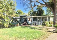 SOLD - CHARMING cottage style home with detached GUEST HOUSE on 1.3 level acres